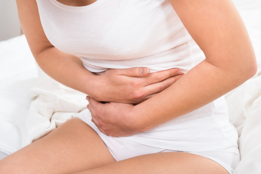 Close-up Of Woman Suffering From Stomach Ache