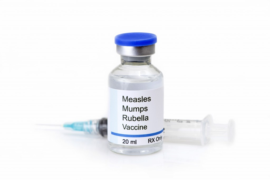 Measles, mumps, rubella, virus vaccine and syringe on white background.