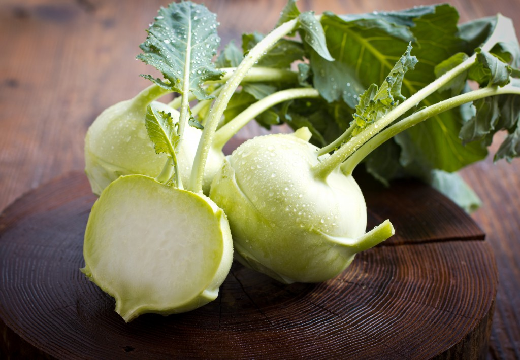 Fresh kohlrabi on the wooden table closeup