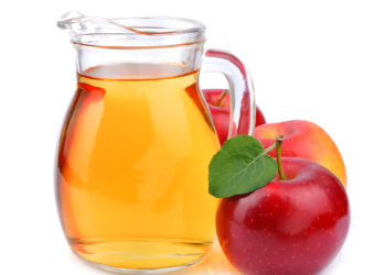Apple juice drinks on white background close up
