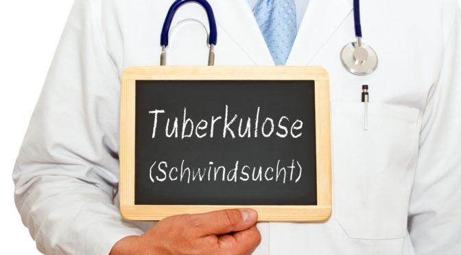 Arzt zeigt ein Schild, auf dem Tuberkulose (Schwindsucht) zu lesen ist