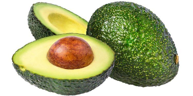 Avocado, ganz und halbiert mit Kern