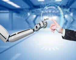 Eine menschliche Hand und eine Roboterhand berühren sich.