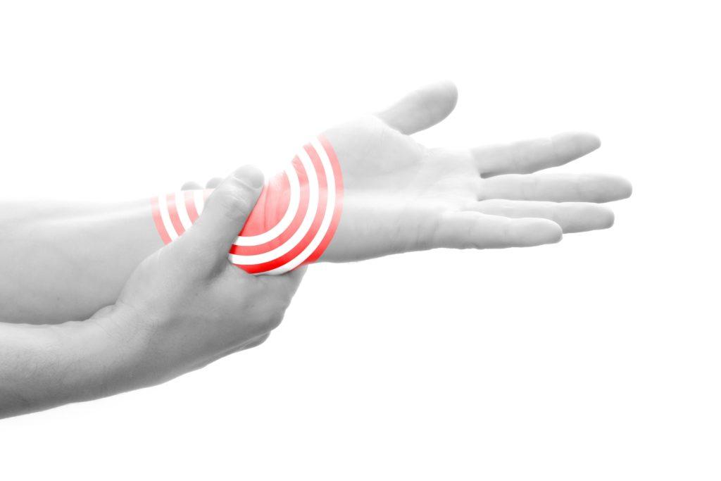 Handgelenk mit Zeichen für Schmerz