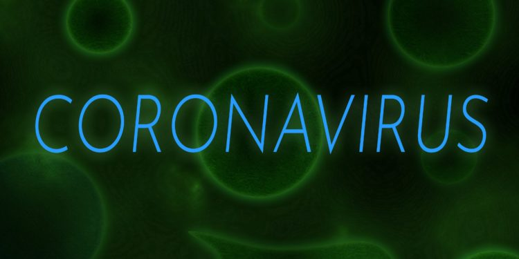 Der Schriftzug Coronavirus vor einem grünen Hintergrund