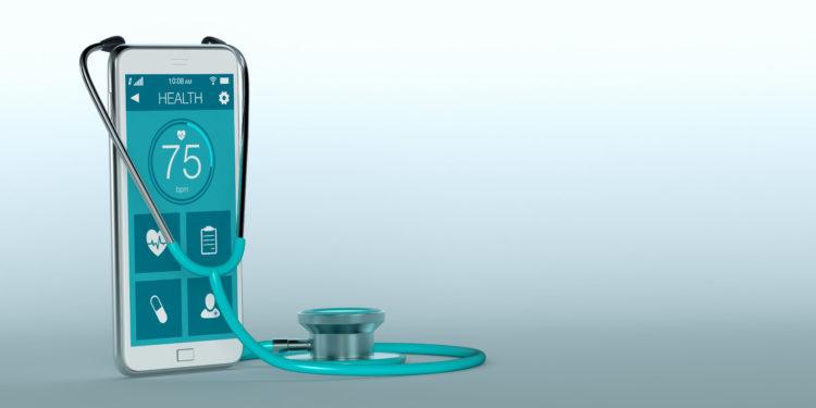 Stethoskop und ein Smartphone mit einer medizinischen App