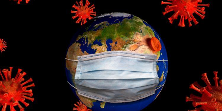Eine Grafik zeigt eine Weltkugel, die eine Atemschutzmaske trägt und von Viren umschwirrt wird.