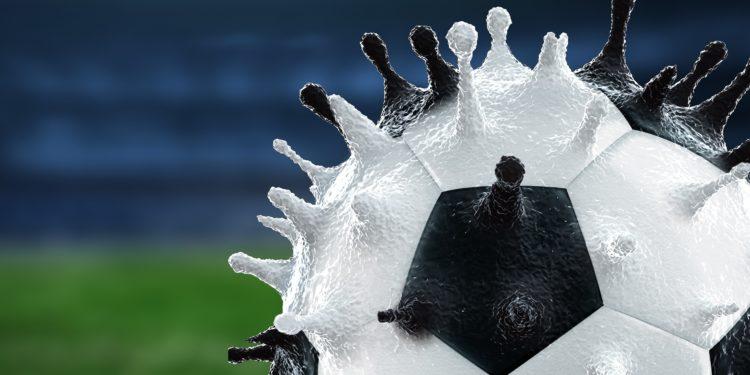Eine grafische Darstellung eines Fußballs, der die Form eines Coronavirus hat.