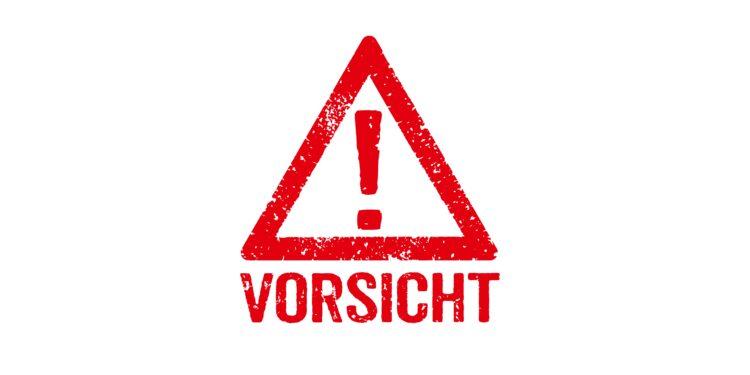 """Rotes Ausrufungszeichen mit dem Hinweis """"Vorsicht"""" darunter."""