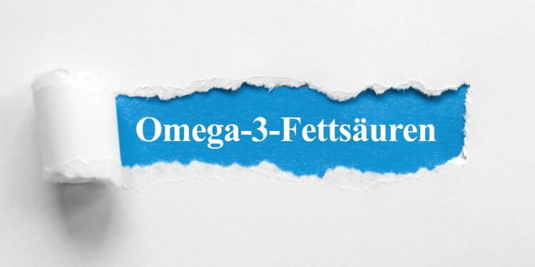 De Schriftzug Omega-3-Fettsäuren unter aufgerissenem Papier