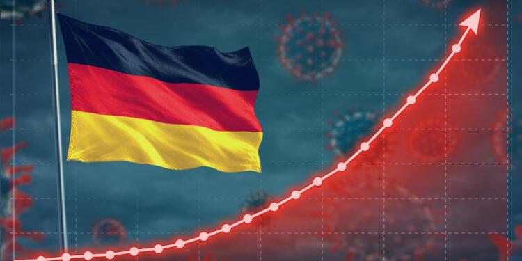 Nach oben steigende Kurve zeigt Coronavirus-Infektionen neben einer Deutschlandfahne