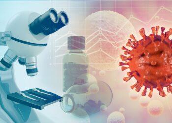 Eine grafisches Darstellung eines Coronavirus der neben einem Mikroskop schwebt.