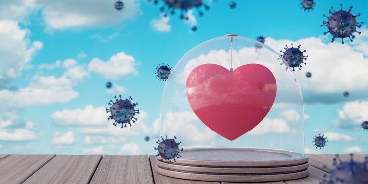 Grafik: Ein Herz ist unter einer Glocke aus Glas vor herumfliegenden Viren geschützt.