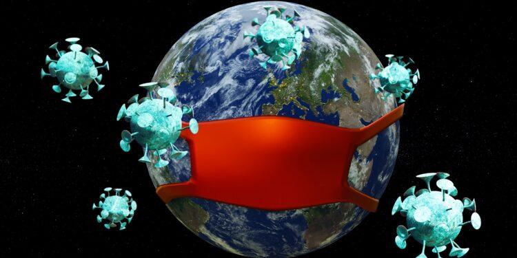 Die Erde mit Mundschutz und umkreist von Coronaviren