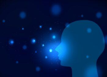 Eine Silhouette eines Kopfes vor blauem Hintergrund.