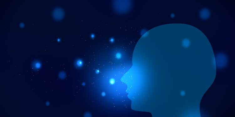 A silhouette of a head against a blue background.