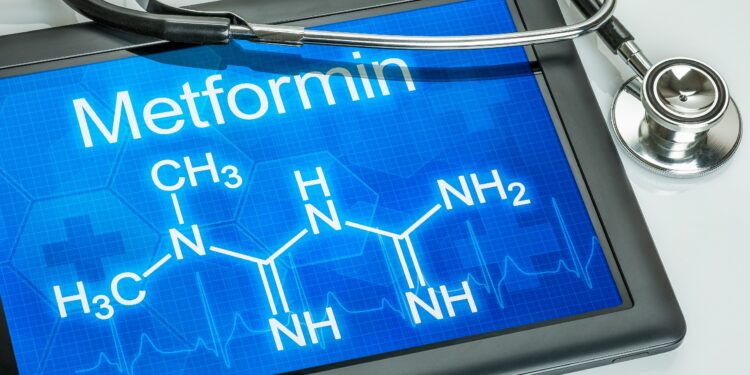 The chemical structural formula of metformin is shown in a tablet.