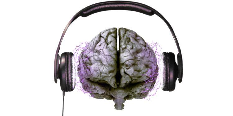 Eine grafische Darstellung eines Gehirn, welches über Kopfhörer beschallt wird.
