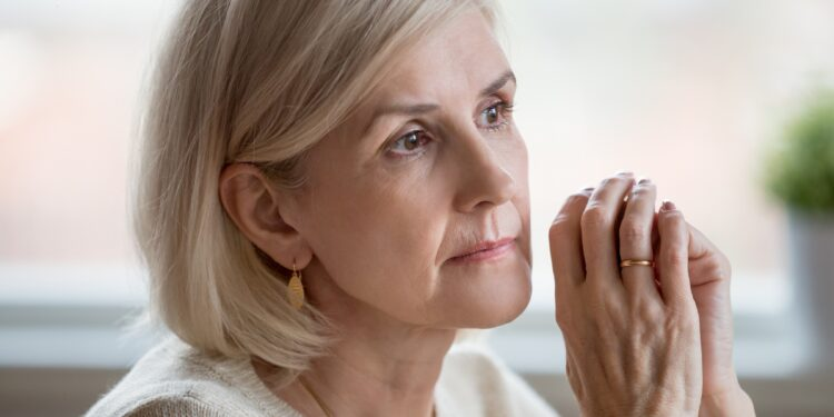 Elderly woman with a thoughtful look