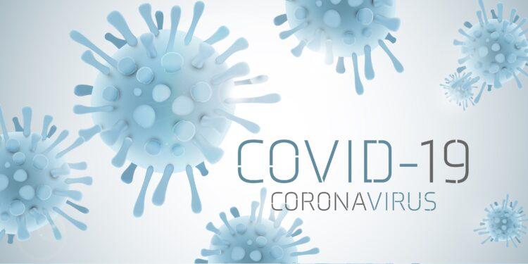 Bild von Virus mit Aufschrift COVID-19.
