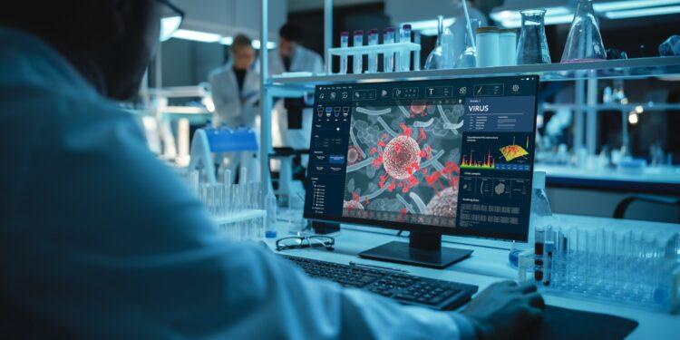 Forscher vor computer mit Bild von Virus.