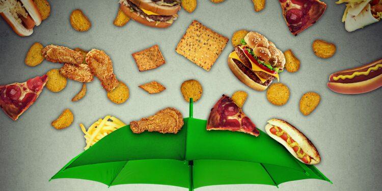 Grafische Darstellung eine Regenschirms, auf den ungesunde Lebensmittel herabfallen.