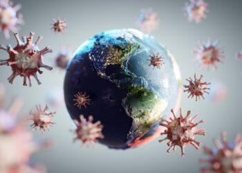 Grafische Darstellung einer Weltkugel, die von Coronaviren umgeben ist.